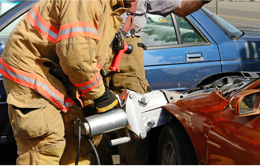 Firefighter holding extrication tool